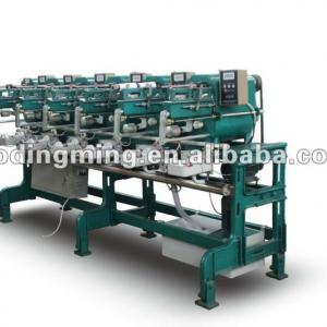 Winding machine with automatic oiling system