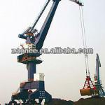 Portal cranes with grab for bulk goods yard